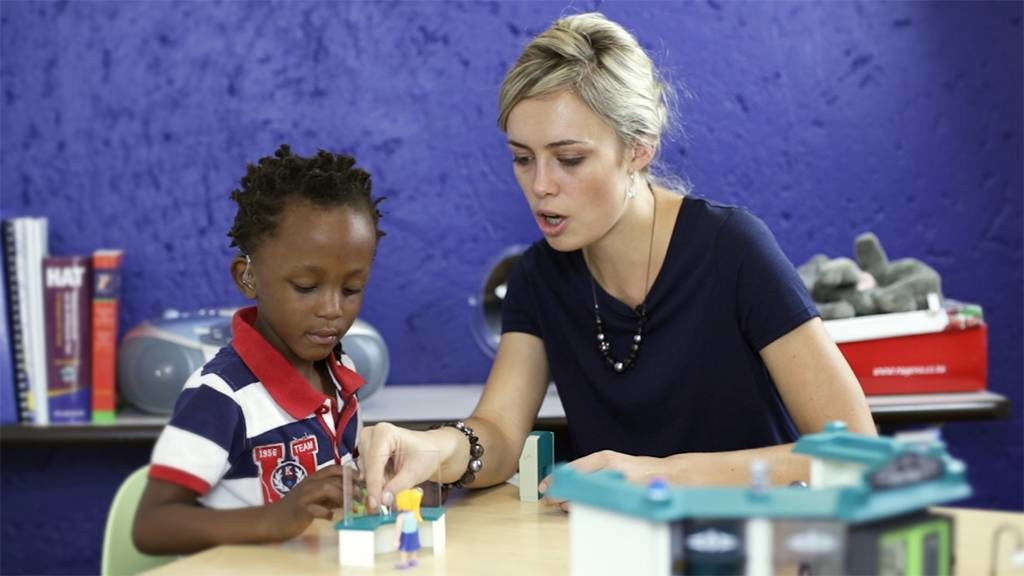 Audiologist working with a deaf child in South Africa.