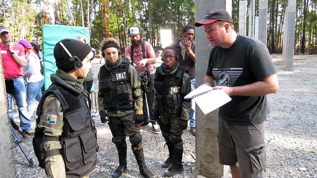 Director Jacques Gombault rehearsing with some of the child actors in the film.