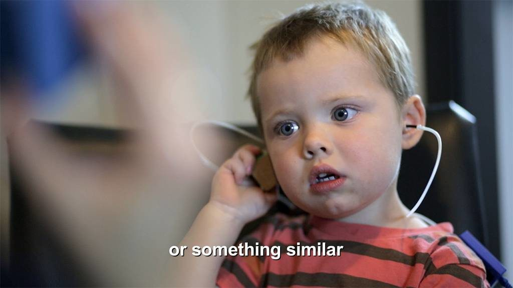 Hearing test being performed on a toddler.